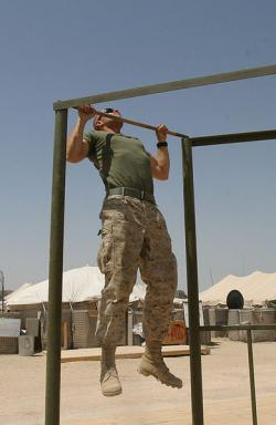 soldier performing pull ups on bar