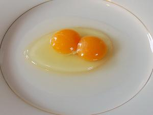 two raw eggs on a plate